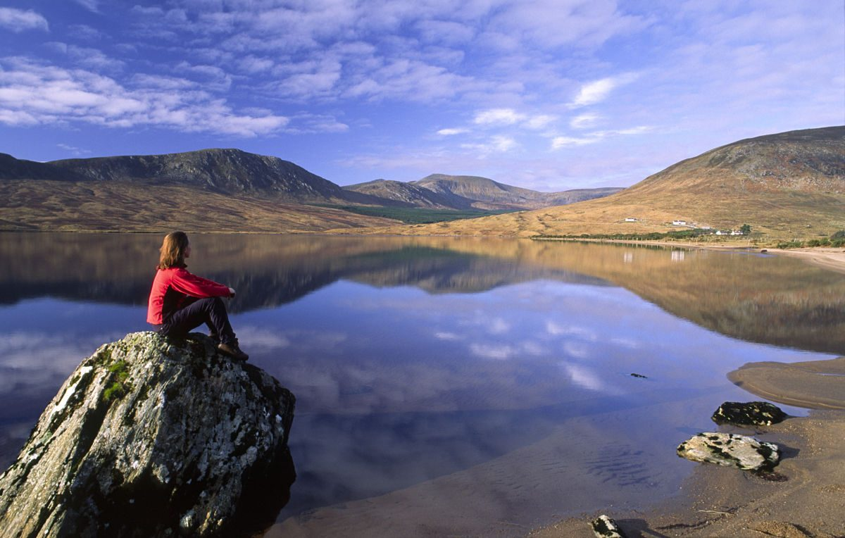Person looking over Lough Feeagh, Nephin Beg