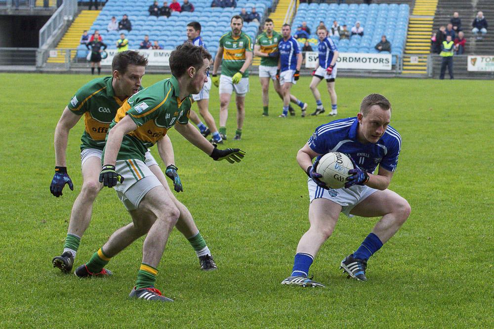Killala's Alex Quinn evades the attention of John Egan of Ardnaree at the Mayo Junior A Championship Final 2015