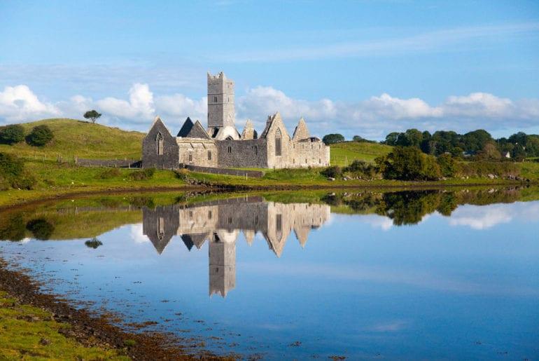 Reflection of Rosserk Abbey, Co Mayo, Ireland.