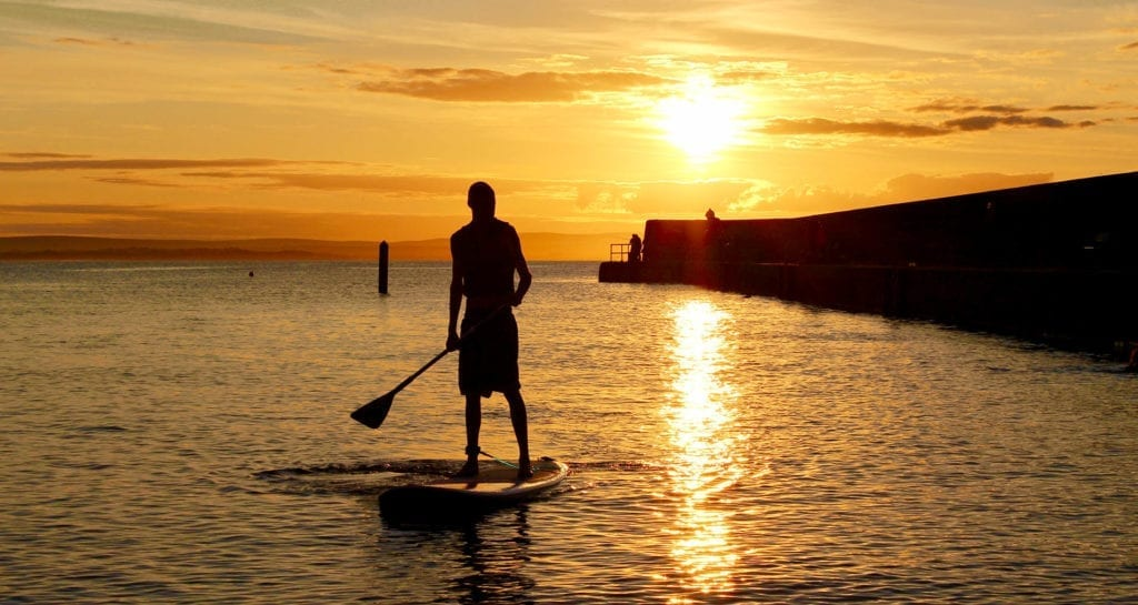 Stand up paddling at Enniscrone, Co. Sligo with Harbour SUP