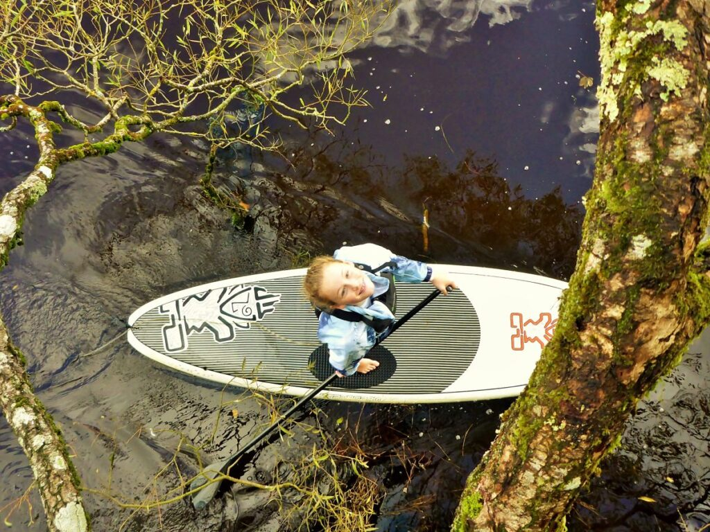 Girl on stand-up paddleboard in Ballina County Mayo taken from above