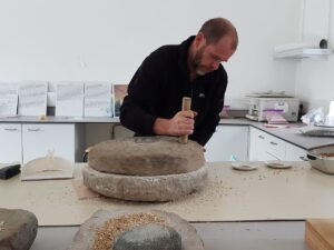 Declan Caulfield and quern at Belderrig Valley Experience