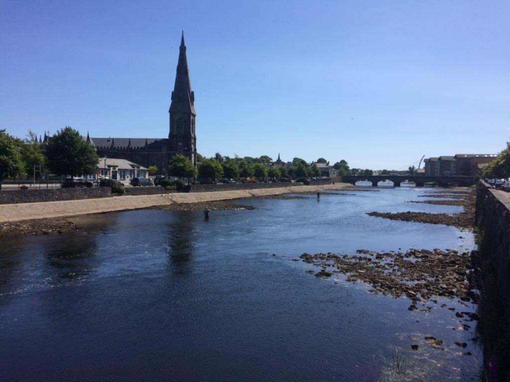 The River Moy in Ballina, County Mayo, Ireland. St. Muredach's Cathedral (pictured) on the banks of the River Moy