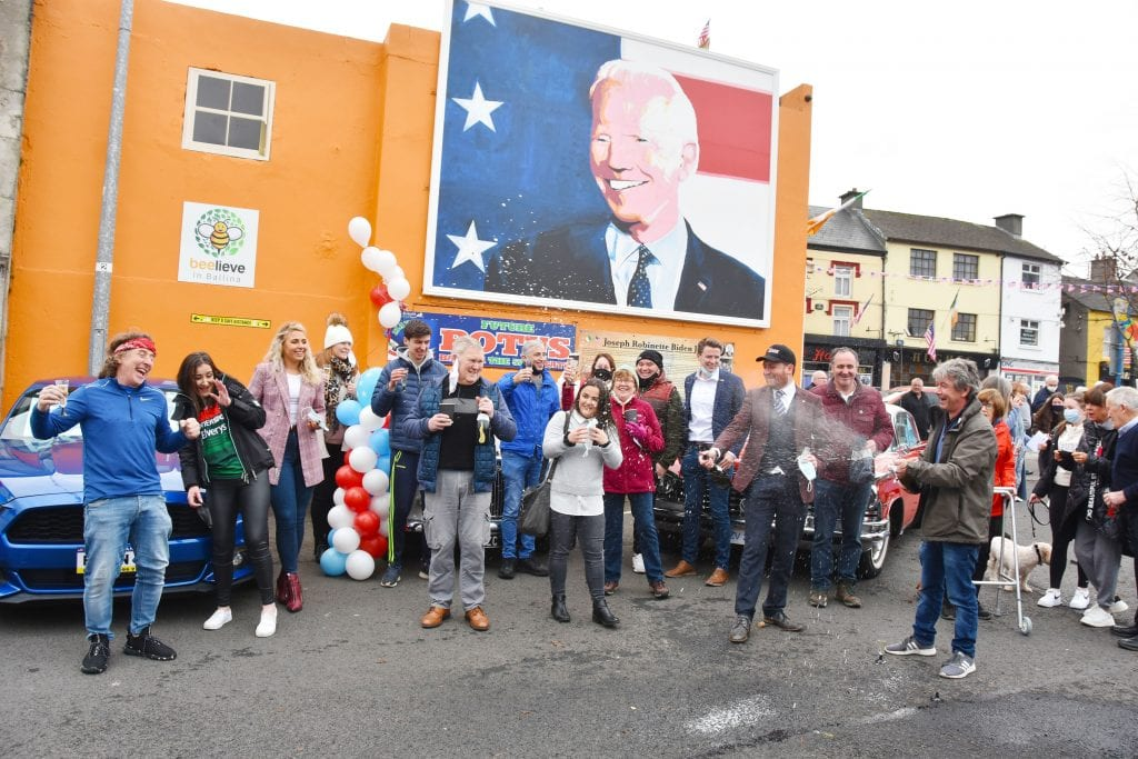Joe Biden Victory Celebrations in the Market Square, Ballina, Co. Mayo with the Ballina Community Clean up team who erected the mural.  Picture: John O'Grady.